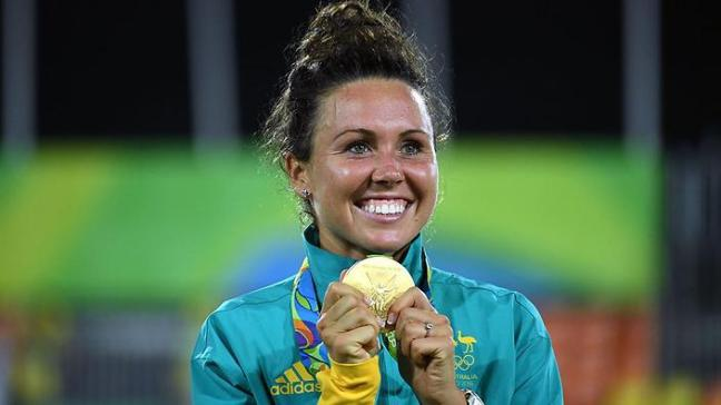 Australia's Chloe Esposito poses with her gold medal in the women's modern pentathlon at the Deodoro Stadium during the Rio 2016 Olympic Games in Rio de Janeiro on August 19, 2016. / AFP / Yasuyoshi Chiba (Photo credit should read YASUYOSHI CHIBA/AFP/Getty Images)